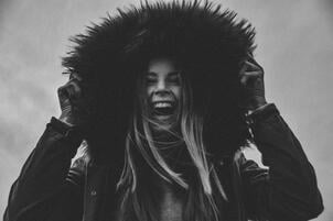 Woman Wearning a Down Jacket with a Fur Hood