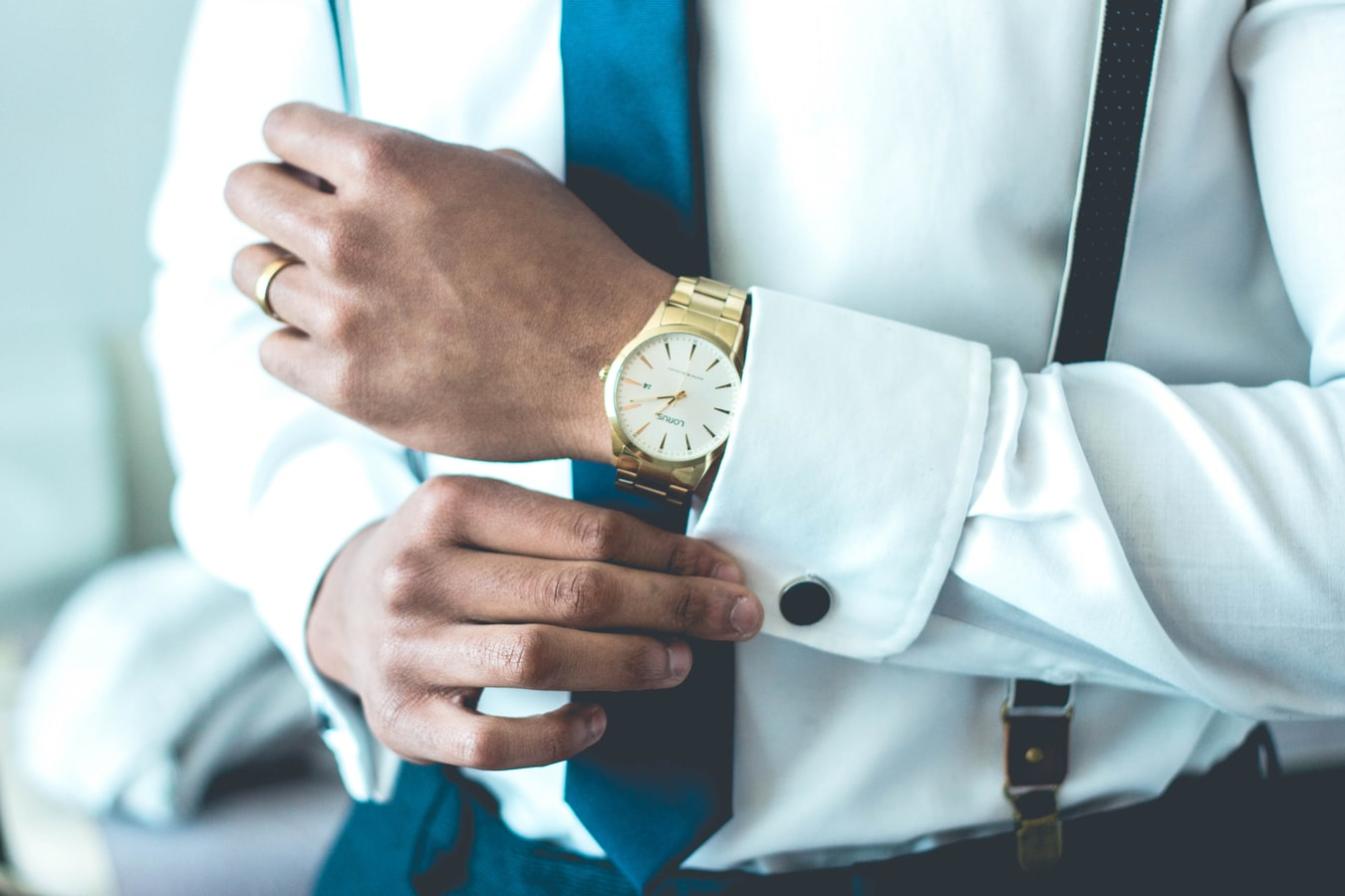 man wearing pressed shirt and watch